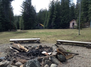 Brownie side fire pit overlooking the Brownie field and one of the Brownie cabins (orange) the building in the background is the old lodge but unfortunately the structure is no longer useable.